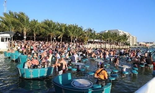 Tables in the water at Seacrets