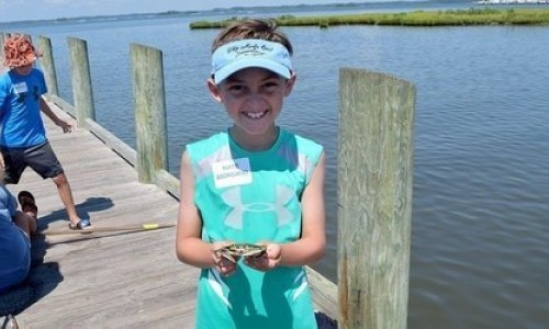 Young Boy Holding Blue Crab