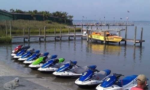 Multiple jet skis on dock